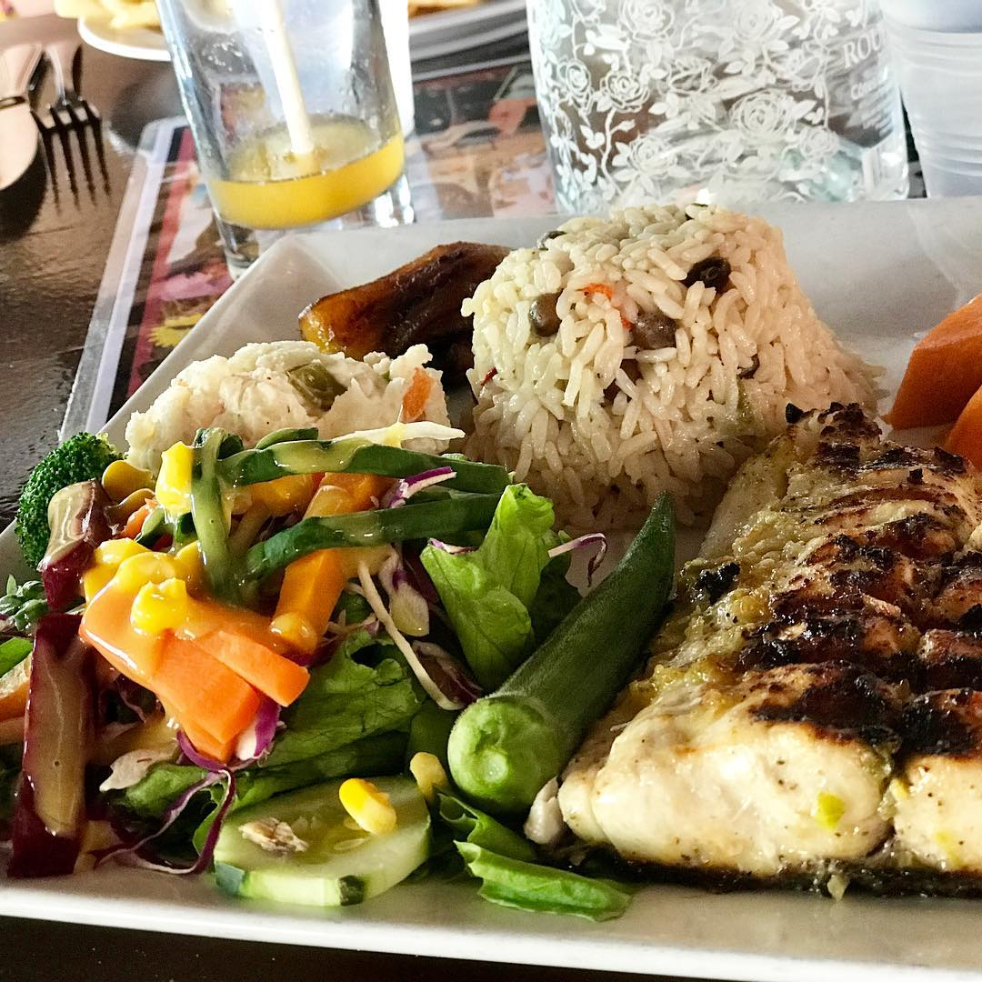 Mahi mahi with okra, beets, carrots, cukes and brown rice and pigeon peas that I swear they cook in coconut water! #yum. . . . #stephaniesdish #carribeanfood #nevis #scagetaway