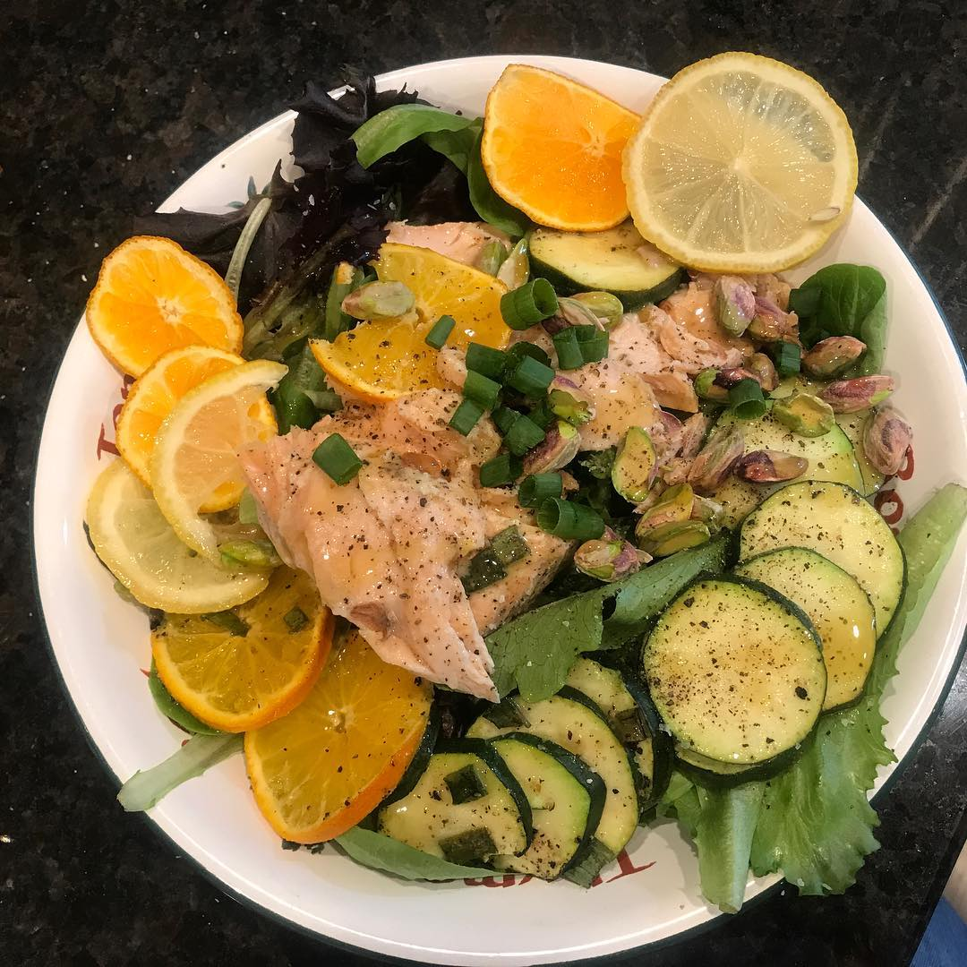 After 2 weeks of amazing vacation food it's back to reality. I made this salmon en papillote salad last night with zuchinni, lemon, oranges and green onions. Marinated the Salmon in @thesaladgirl #Citrus Splash. I feel lighter already! I am coming for you Spring! . . . #stephaniesdish #salads #saladsfordinner #saladgirlsaladsister #saladgirlsaladdressing #partner #healthyeating #cleaneating #salmon